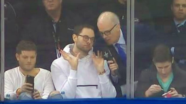 A fan at the Lightning-Rangers game gave a pre-game show during an interview with Scott Oake. He can be seen here showing off his gold chain.