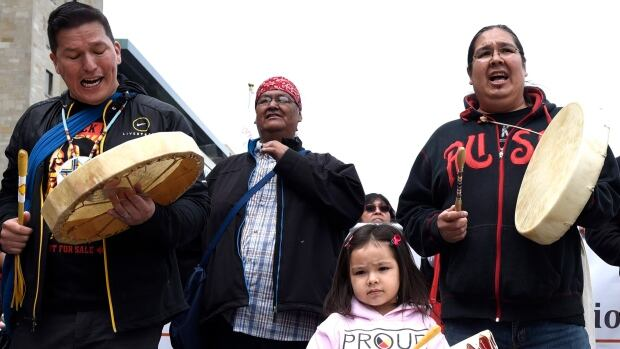 Nikamuwin Mianscum, 3, stands with drummers as they lead the Walk for Reconciliation, part of the closing events of the Truth and Reconciliation Commission on Sunday in Ottawa and Gatineau. The commission uncovered horror stories of homemade electric chairs, malnutrition experiments and the deaths of more 6,000 children in residential schools.