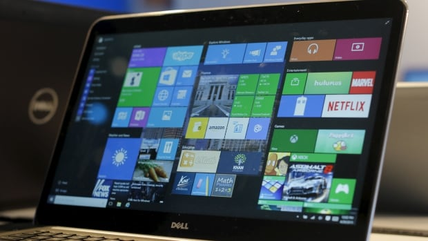 A laptop computer featuring Windows 10 is seen on display at Microsoft Build in San Francisco in April. Even people who haven't indicated they want Windows 10 may be getting it downloaded to their computer, Microsoft confirmed.