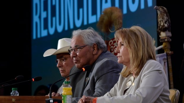 Justice Murray Sinclair, centre, and fellow Truth and Reconciliation commissioners Marie Wilson, right, and Wilton Littlechild discuss their report on Canada's residential school system in Ottawa this week. The report called for more resources for First Nations, even as an internal report suggests Aboriginal Affairs is holding back promised money.