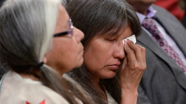 A woman wipes a tear during the closing ceremony of the Indian Residential Schools Truth and Reconciliation Commission, at Rideau Hall in Ottawa on Wednesday, June 3, 2015. THE CANADIAN PRESS/Sean Kilpatrick