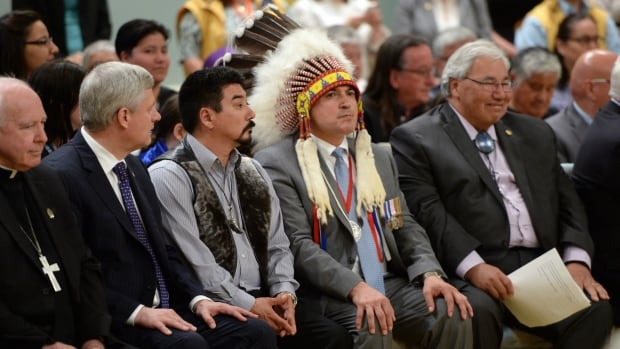Prime Minister Stephen Harper, second from left to right, and Inuit Leader Terry Audla, President of Inuit Tapiriit Kanatami, AFN Chief Perry Bellegarde and Commission chairman Justice Murray Sinclair listen during the closing ceremony of the Indian Residential Schools Truth and Reconciliation Commission, at Rideau Hall in Ottawa on Wednesday, June 3, 2015. THE CANADIAN PRESS/Sean Kilpatrick