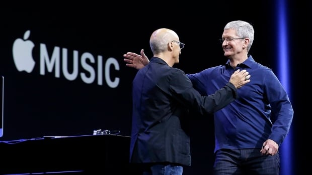 Apple CEO Tim Cook, right, hugs Beats by Dre co-founder and Apple employee Jimmy Iovine at the Apple Worldwide Developers Conference. The maker of iPods and iPhones announced Apple Music, its new, paid streaming-music service to launch this summer.