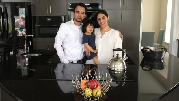 Murad Ali, his wife, Arsheen Haji, and their daughter, Shanzé, in their custom kitchen paid for with a home equity line of credit.
