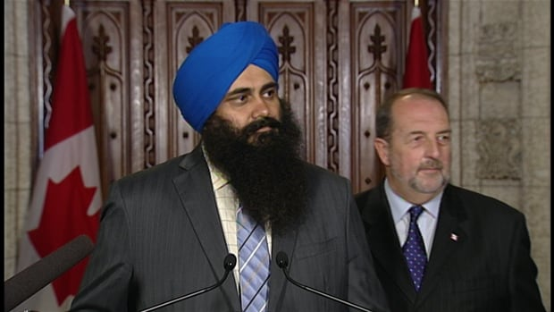 Multiculturalism Minister Tim Uppal and Infrastructure Minister Denis Lebel told reporters Wednesday that the Harper government would soon introduce new legislation to ban face-coverings at citizenship ceremonies.