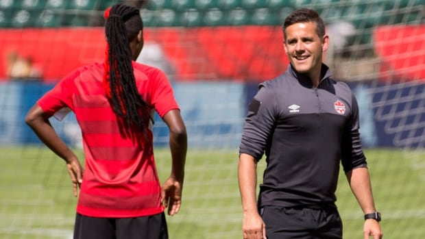 Canada's head coach John Herdman and Kadeisha Buchanan chat during a practice session in Edmonton on June 5, 2015. Four years ago, Herdman led New Zealand to its first ever point at the FIFA Women's World Cup.