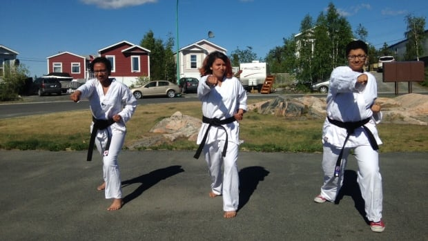 Yellowknife sisters Delilah, 15; Safiya, 12; and Ayla, 16, scored a rare trio last Saturday: they all earned their black belts in Taekwondo, at the same time.