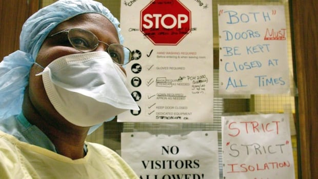 A nurse wears protective clothing at Sunnybrook Hospital in Toronto in March 2003. For the people who fought Toronto's devastating SARS outbreak that year, the news of MERS in South Korea sounds eerily familiar, but experts say we're better equipped this time around.