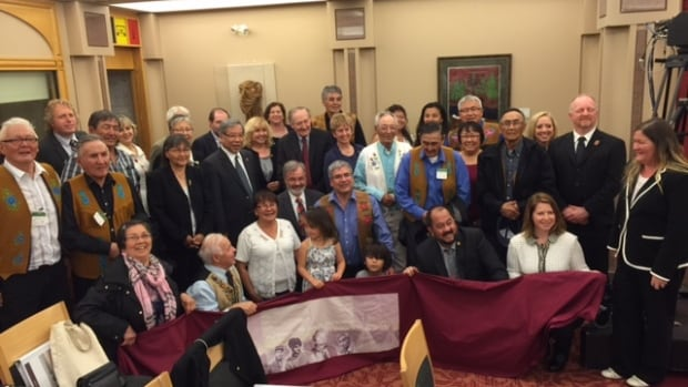The congregation from Deline poses with several senators in Ottawa following the passing of their self-government agreement - the first of its kind in the Northwest Territories
