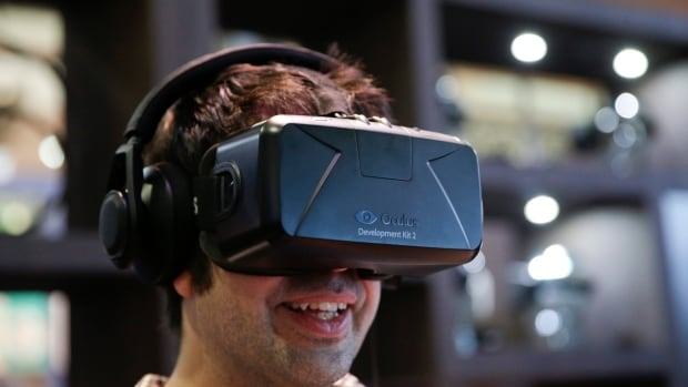 A man tries out the Oculus Rift virtual reality headset at the 2014 Electronic Entertainment Expo. CBC Radio's Dan Misener argues the technology isn't ready for a major consumer breakthrough just yet.