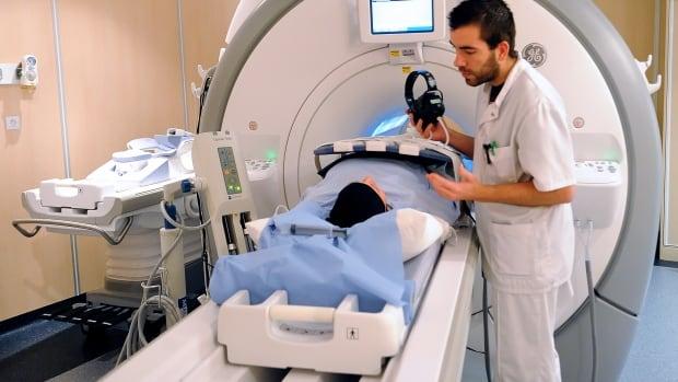 A patient prepares to undergo a MRI.