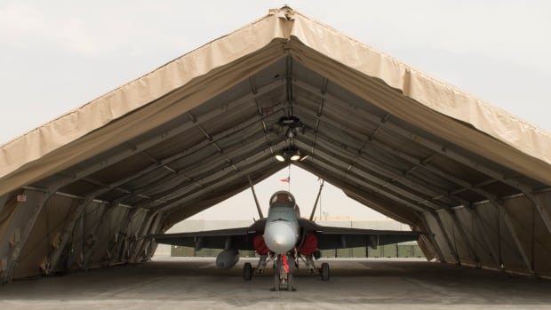 A CF-188 Hornet jet sits inside a special shelter at Camp Patrice Vincent in Kuwait in May.