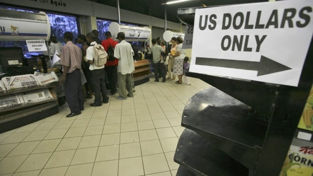 Zimbabwe's economy has been running on U.S. dollars for years, but this week the government formally urged people to trade in their old Zimbabwean bank notes at a rate of 35 quadrillion to one.