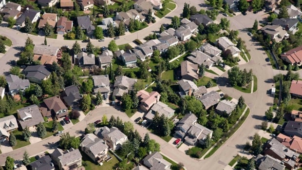 A file photo of aerial views of Calgary housing in 2013. Richard White says new suburbs are including retail, business, medical and different types of housing.
