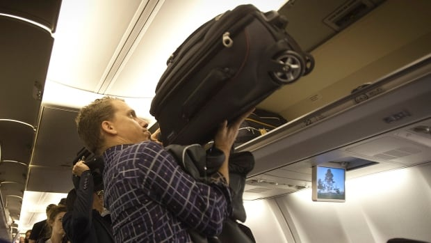 The International Air Transport Association has introduced what it considers an optimal size for carry-on bags, but says the smaller size is not meant to be mandatory.