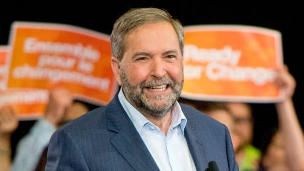 NDP leader Tom Mulcair speaks at a rally in Ottawa on Wednesday. Mulcair has been unclear which tax bar the NDP will use as a benchmark in his vow to raise Canada's corporate taxes.