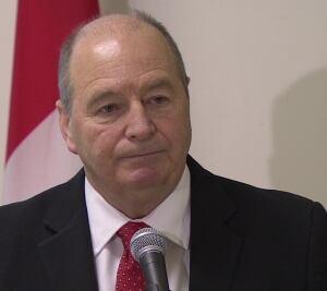 Finance Minister Allen Roach