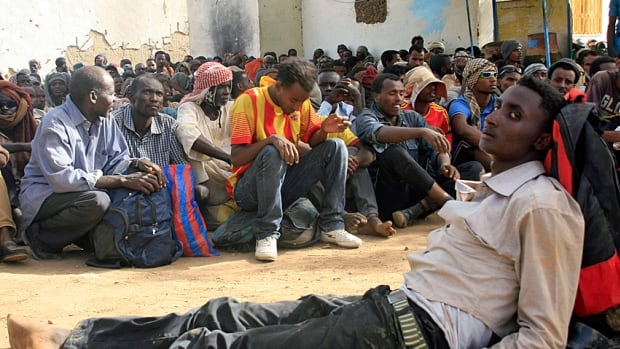 Illegal immigrants, abandoned by traffickers in a desert area between Sudan and Libya on their way to Mediterranean ports, wait inside a military base in Dongola.