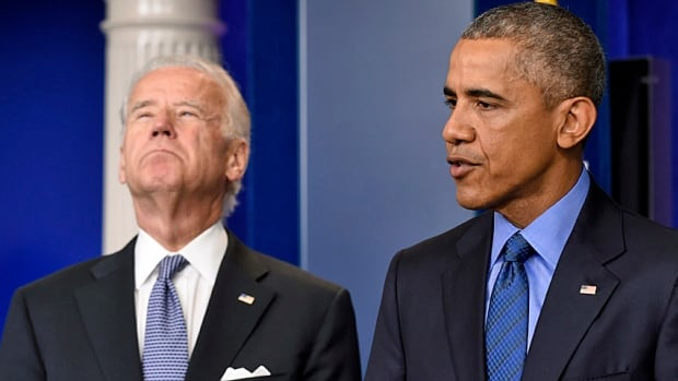 President Barack Obama, accompanied by Vice-President Joe Biden, speaks to reporters about the church shooting in Charleston, S.C.