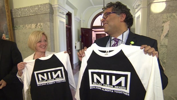 "Alberta Premier Rachel Notley and Calgary Mayor Naheed Nenshi show off their ""Notley Iveson Nenshi"" t-shirts to reporters at the Alberta legislature."