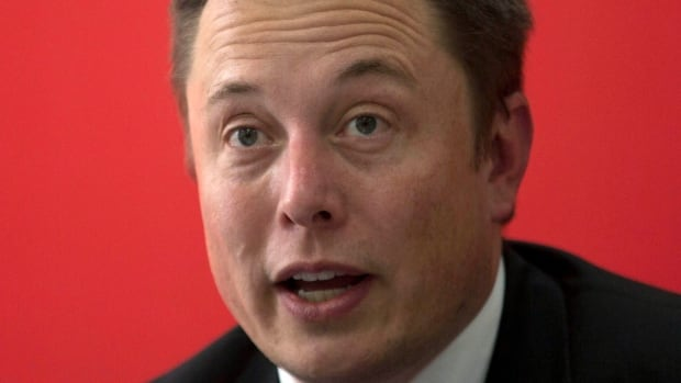 "'""It's pretty hard to hide anything if you hire over 1,000 engineers to do it,' said Tesla CEO Elon Musk. seen here in a 2014 photo, in an interview with BBC News."