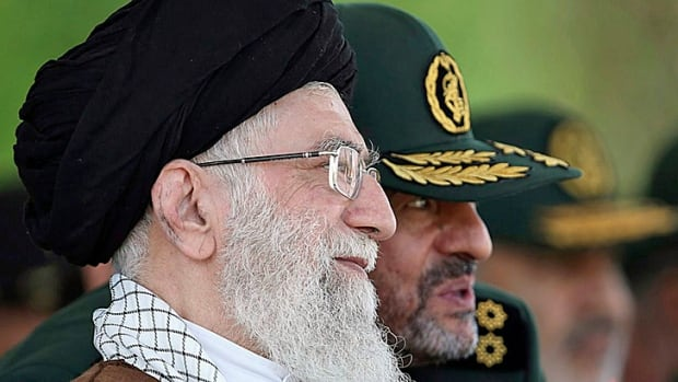 What will this man do? Iranian supreme leader Ayatollah Ali Khamenei listens to Revolutionary Guard commander Mohammad Ali Jafari during a graduation ceremony in May.