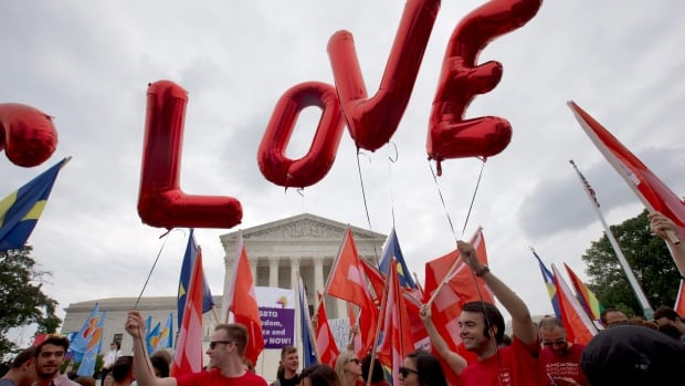 Same-sex marriage supporters take to the streets of the nation's capital to express their joy with Friday's U.S. Supreme Court decision.