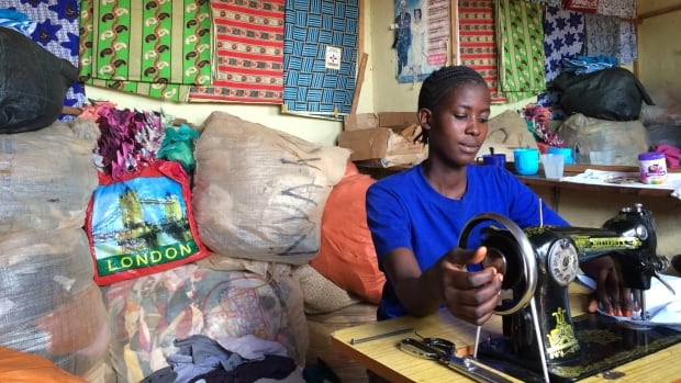 Martina Daniel, who ran away from home to avoid female genital mutilation and then convinced her parents not to go through with it, now works as a seamstress in a shop in Tarime, Tanzania that employs former child brides.