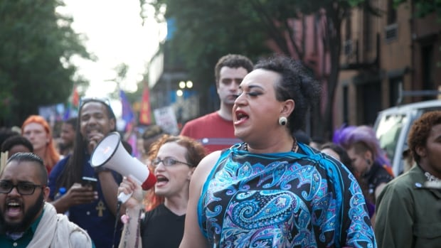 Marchers supporting rights of transgender people demonstrate in Greenwich Village on Friday. Although the U.S. Supreme Court ruling guaranteeing marriage rights to the LGBT community are an advancement, activists say, the trans community is still fighting for basic protections from discrimination.