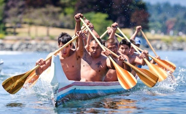 First Nations competitors from the Rainbow Canoe Club in Kulleet Bay race to the line in the first aboriginal war-canoe race in over 100 years in the Inner Harbour of Victoria, B.C., on June 27, 2015.