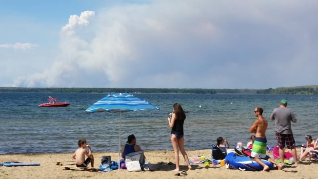 Smoke plumes from wildfires could be seen from Waskesui Beach on Sunday.