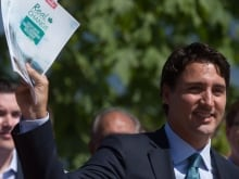 Liberal Leader Justin Trudeau holds up his party's platform at a press conference in Waterloo, Ont. on Monday, October 5, 2015.