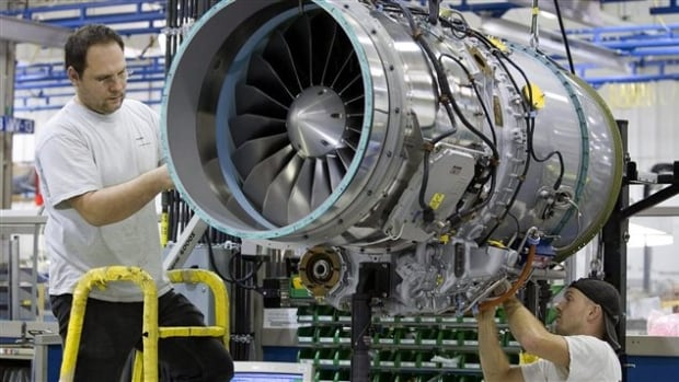 A worker builds a jet engine at a factory in Quebec. According to the OECD, Canada's economy is going to perform worse than previously anticipated this year and next.
