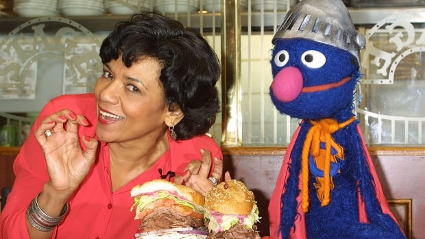 Sesame Street actress Sonia Manzano, in character as Maria Rodriquez with Muppet Grover, in 2002, has announced she's leaving the long-running PBS children's show after nearly 45 years.