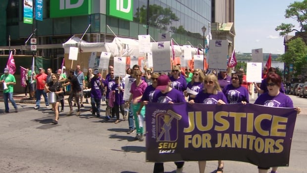 Representatives presenting cleaners protested outside the TD Centre at noon on Friday.