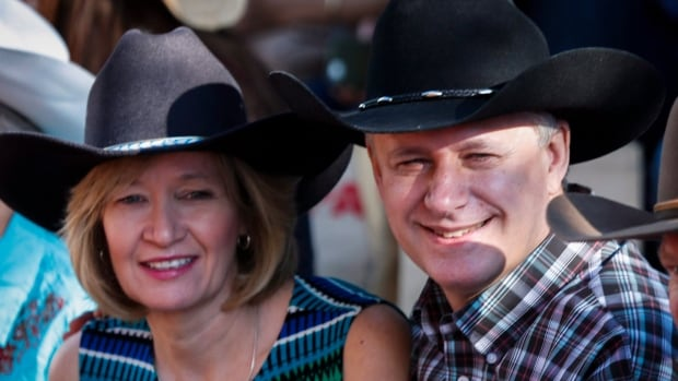 Prime Minister Stephen Harper, at the Calgary Stampede with his wife, Laureen, told reporters there he is confident Calgary and Alberta will 'bounce back quickly' from the current oil sector dip.