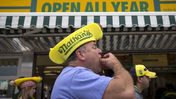 A recent WHO report on the link between processed meat and cancer is unlikely to stop people from taking part in events like Nathan's Famous Hot Dog Eating Contest.