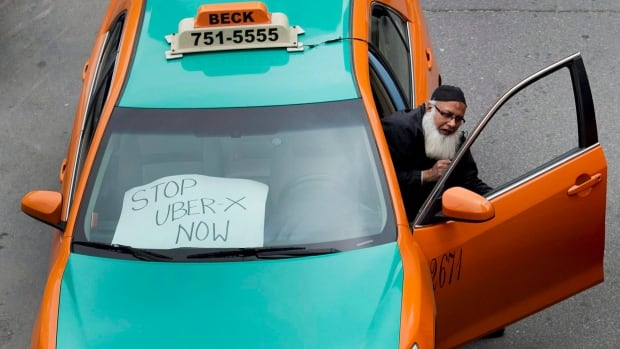 A Beck taxi driver joins a protest against ride-sharing service Uber. On Tuesday, Beck Taxi called on the city to drop the meter rate for the city's drivers.