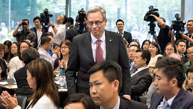 Minister of Finance Joe Oliver prepares to speak at the Canada-China Finance Summit in Toronto on Wednesday, where he reiterated his view that Canada's economy will pick up later in the year.