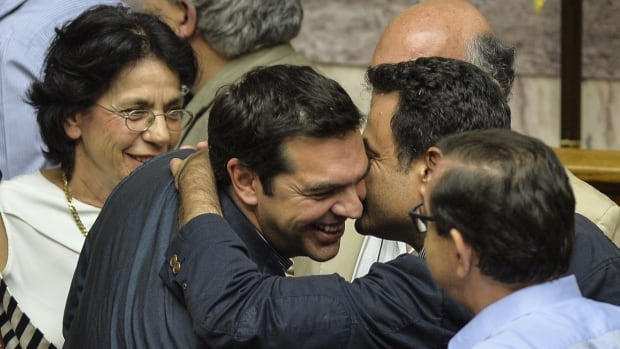 Greek Prime Minister Alexis Tsipras is congratulated by coalition members at the end of  a session at the Greek parliament in Athens. His government's most recent proposal will be the basis for negotiations with creditors as the country looks for fresh financing.