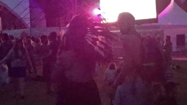 A woman was sighted wearing a traditional First Nations headdress at the Main Stage at Winnipeg Folk Festival Saturday.