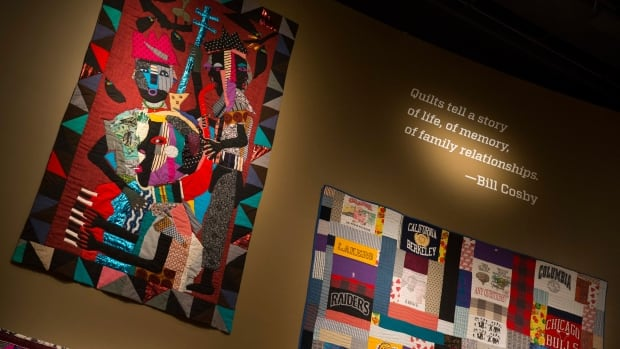 Quilts from the Bill and Camille Cosby collection hang at the Smithsonian's National Museum of African Art in Washington.