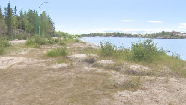 Frame Lake sits in the centre of the City of Yellowknife, and has a heavily-used recreation trail around it. 'It's a healthy-looking lake when you look at it, but when you actually investigate it, it's not,' says biologist Pete Cott.