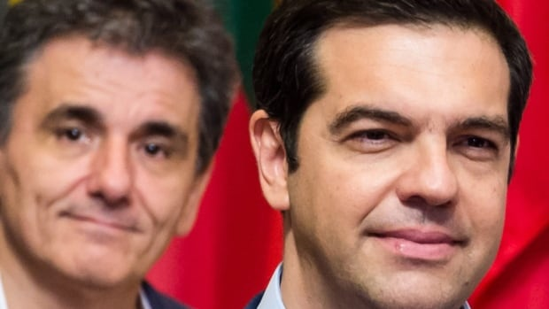 Greek Prime Minister Alexis Tsipras, right, and Greek Finance Minister Euclid Tsakalotos look relieved on Monday after reaching a deal Sunday with their eurozone partners. The deal will mean far-reaching economic and social reforms for the debt-ridden country.