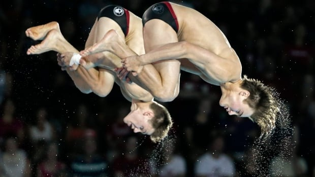 Philippe Gagne, right, and Vincent Riendeau, seen here en route to a silver medal at the Pan Am Games, won another silver medal Saturday at the FINA Diving Grand Prix event in Germany.