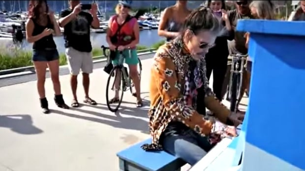 Aerosmith's Steven Tyler surprised a handful of fans by playing at a free piano in downtown Kelowna, B.C.