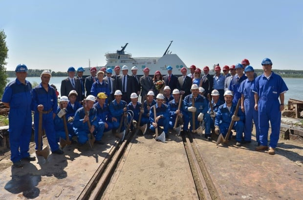 Workers and officials at MV Legionnaire launch