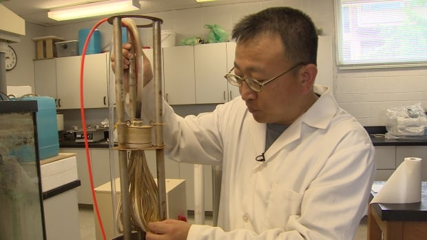 Acadia University chemist Anthony Tong demonstrates how his membrane bioreactor works. Testing will soon begin to see if the device can eliminate pharmaceuticals from waste water.