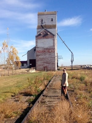 Ali Piwowar in front of Indian Head grain elevator