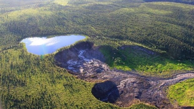 This lake, near Fort McPherson, N.W.T., is poised to disappear when a permafrost slump encroaches on its edges. A flash flood could happen at any moment, according to the N.W.T. Geological Survey.